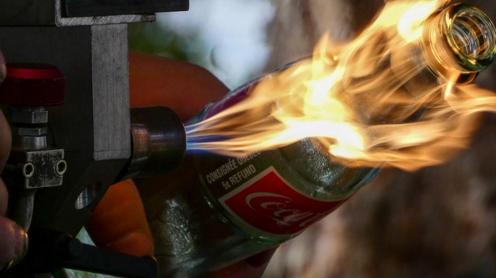 shallow focus photo of burning glass bottle