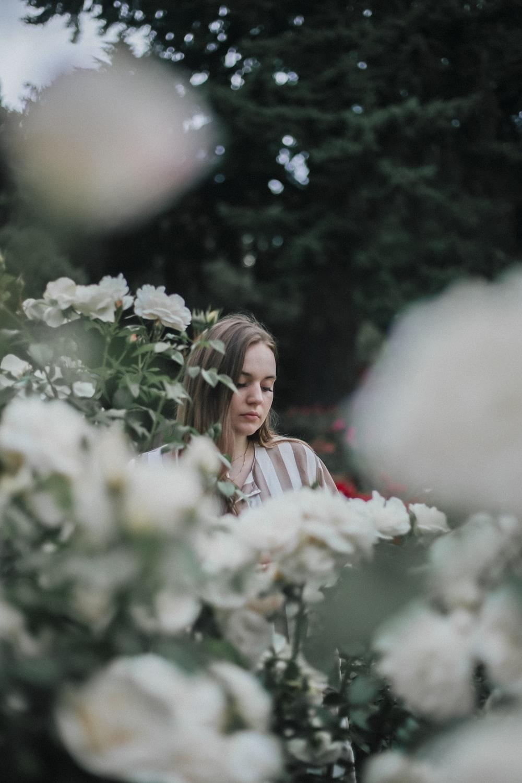 woman near white flowers