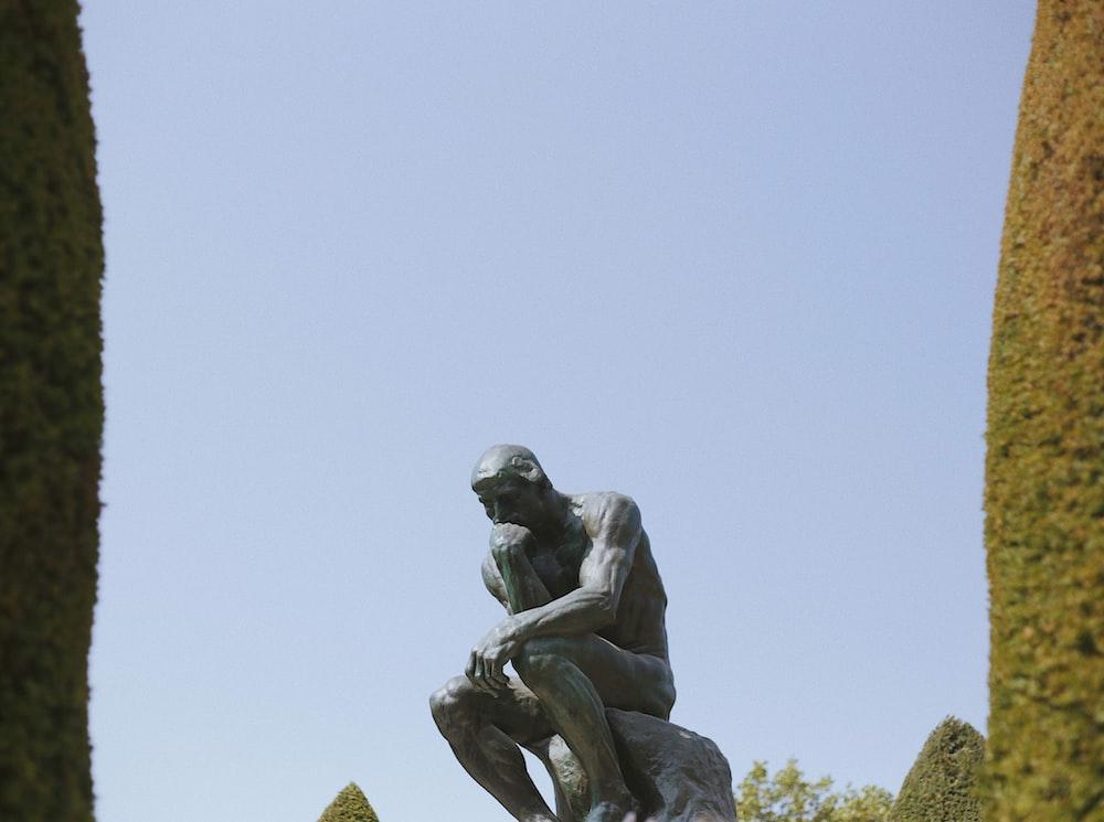 man sitting statue