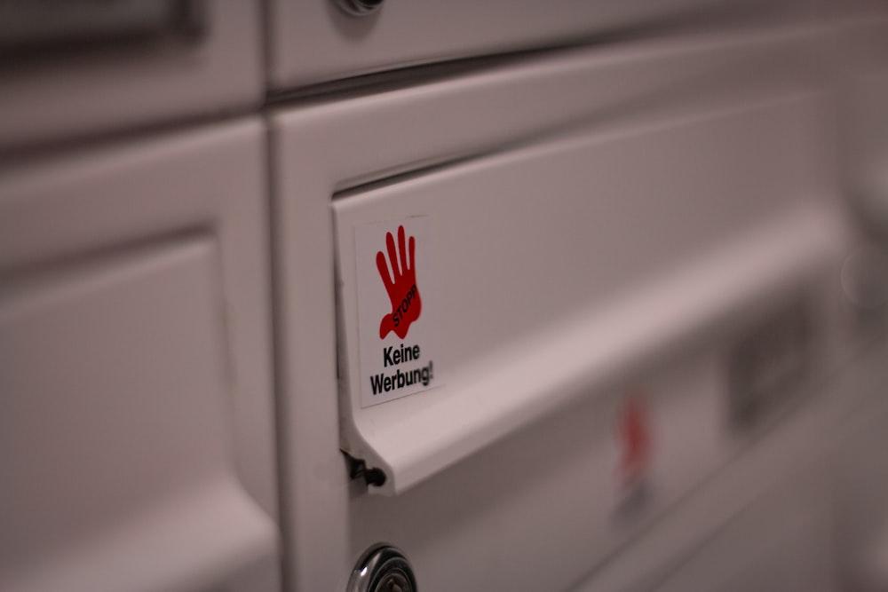 white sticker on white wooden drawer