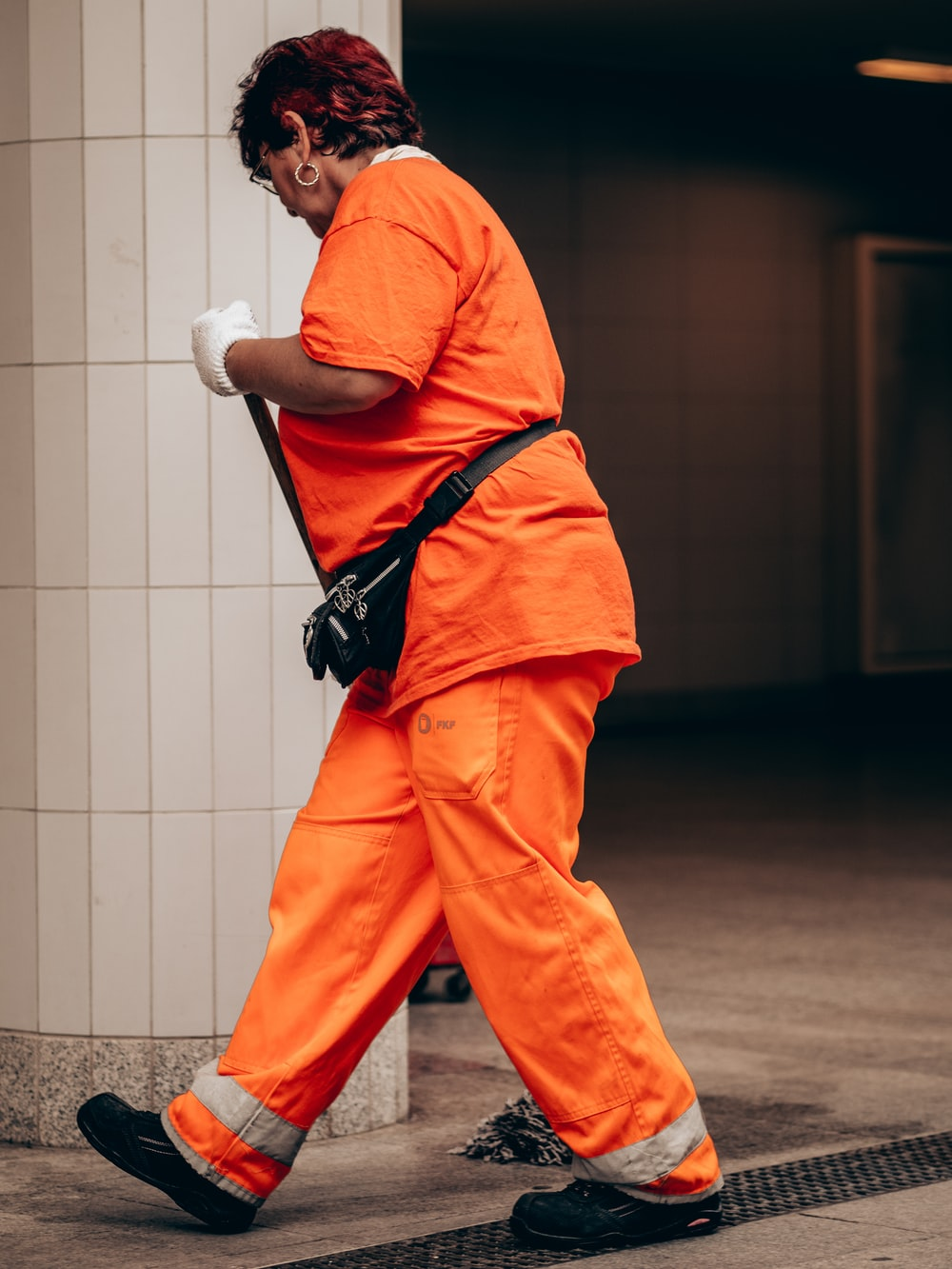 woman wearing orange t-shirt and pants