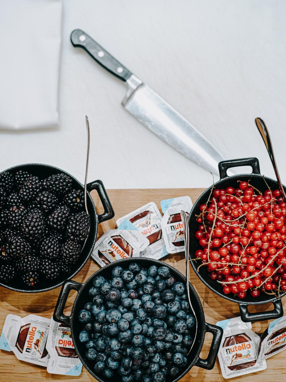 berries and currants filled crock pots