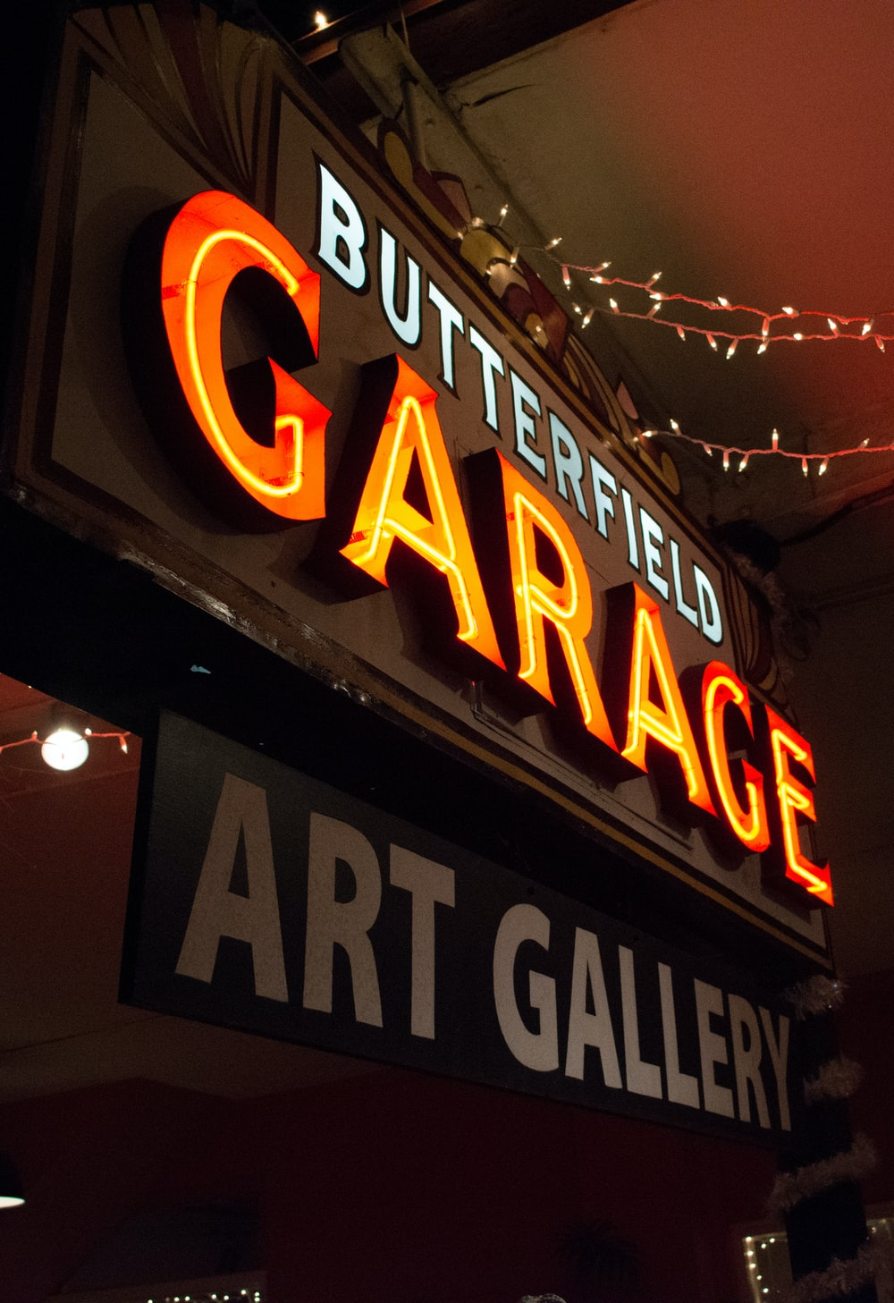 turned-on Butterfield Garage neon sign