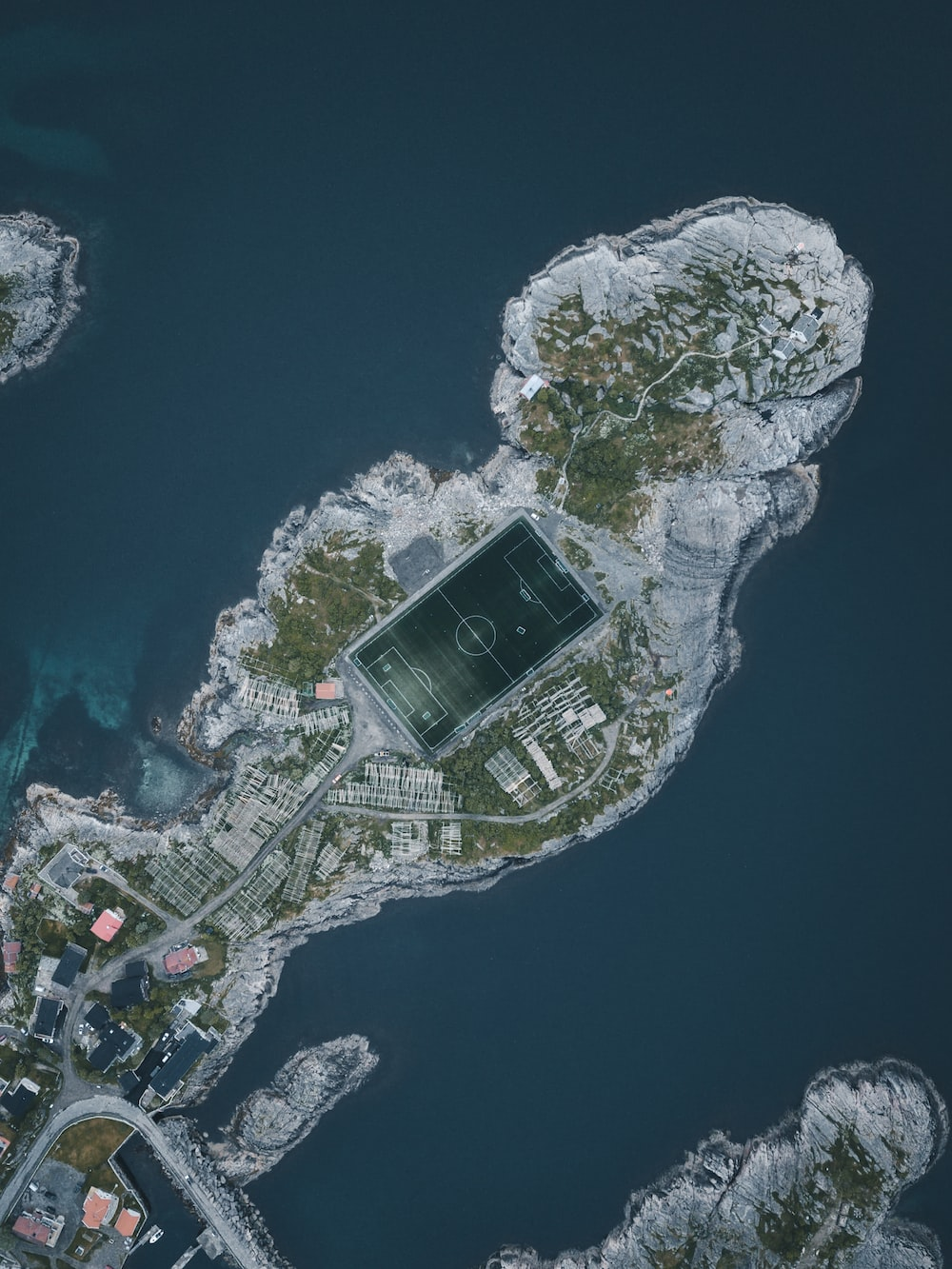 aerial photography of island with sport court