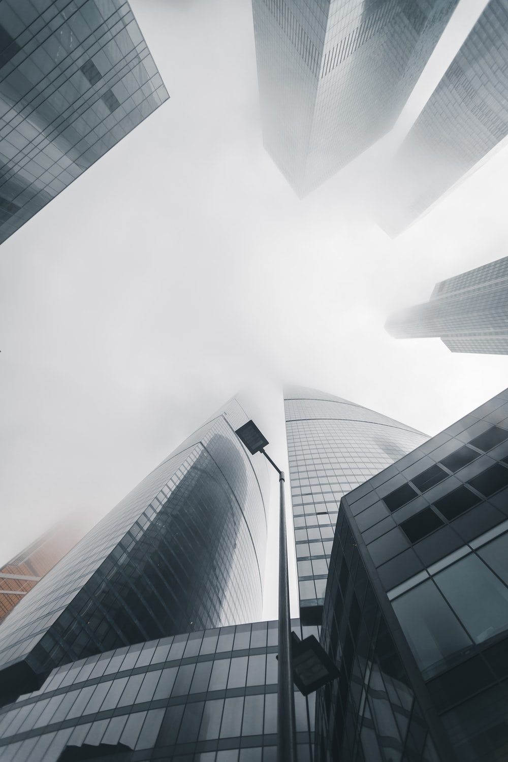 low-angle photography of high-rise buildings