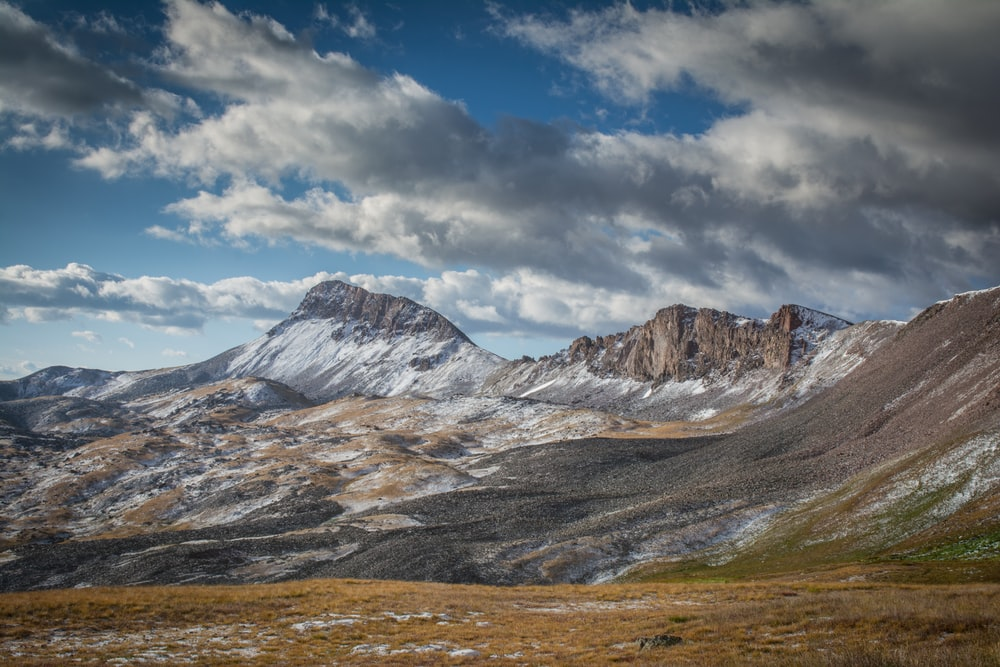 landscape photography of a mountain under a cloudy sky