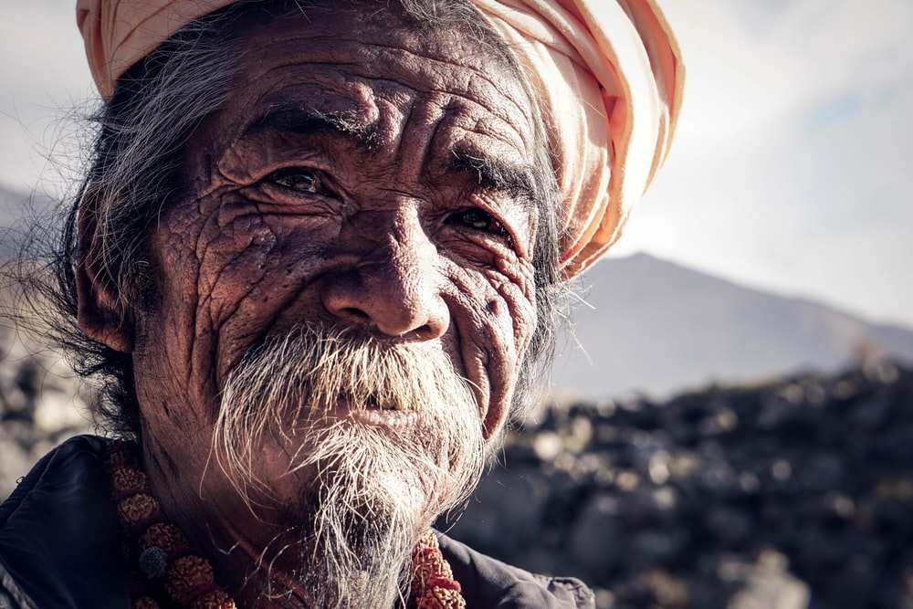 portrait of man wearing orange turban