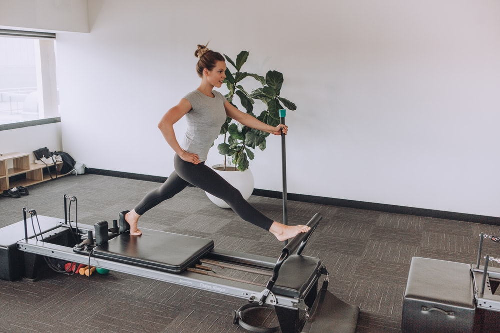 woman exercising using equipment