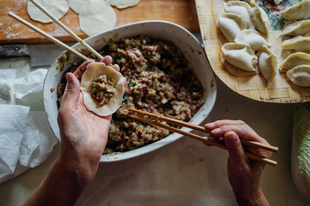 person making dumplings