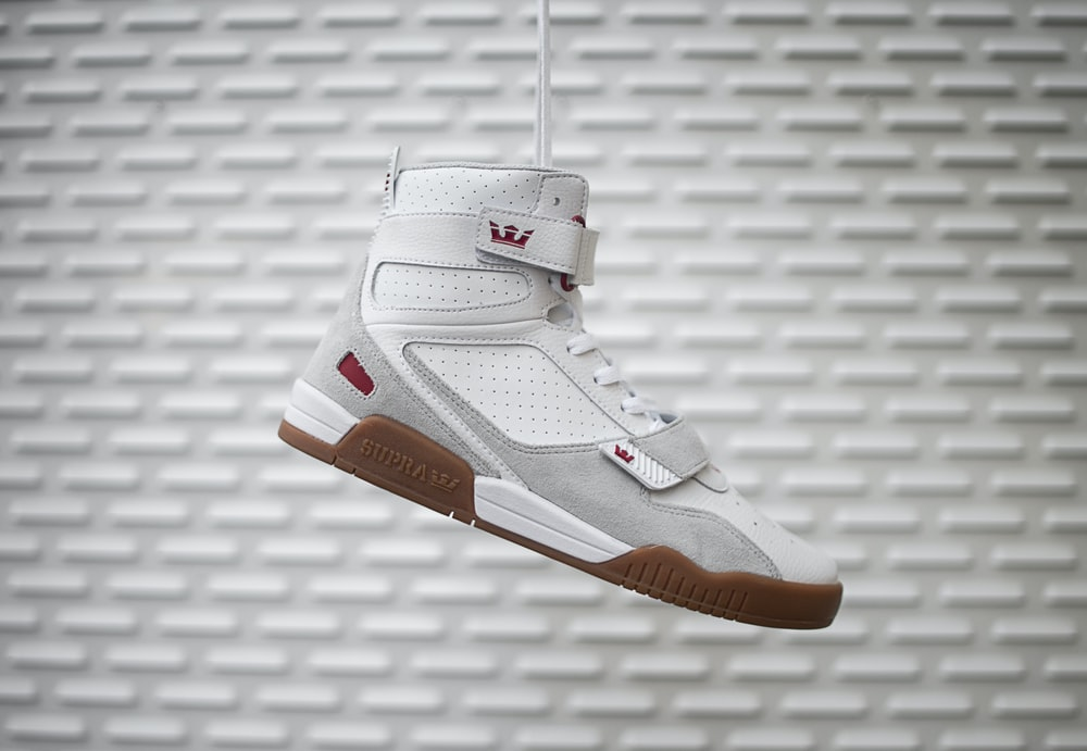 unpaired white, brown, and silver LeBron shoes