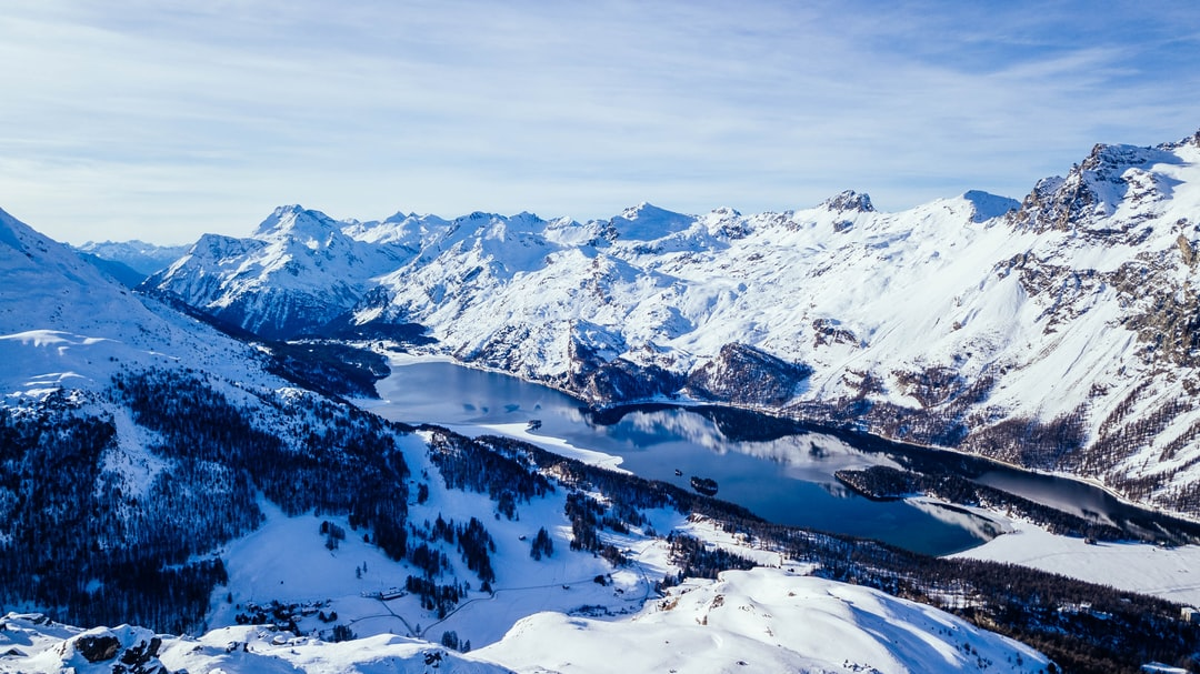 """Lake """"Silsersee"""" in the swiss alps on a sunny winter day."""