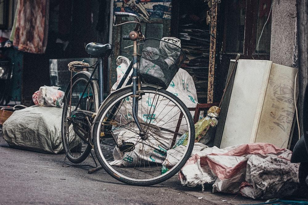black dutch bike near sacks