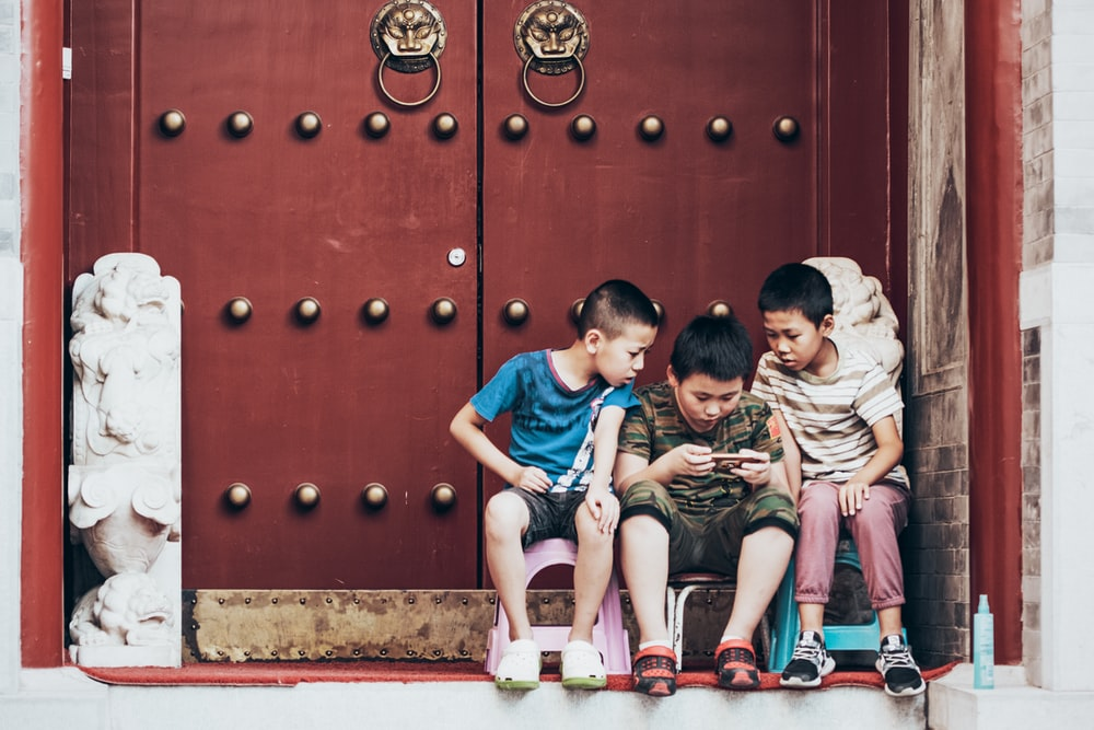 boy's playing on smartphone