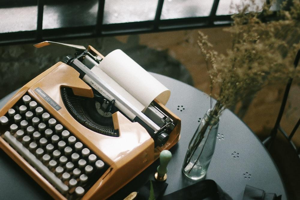 beige and white typewritter