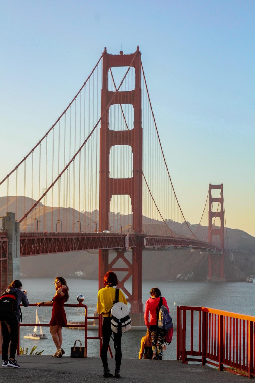 people near Golden Gate bridge during daytime