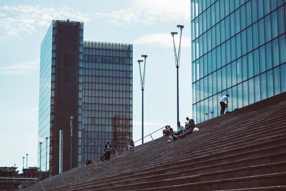 people on stairs near building