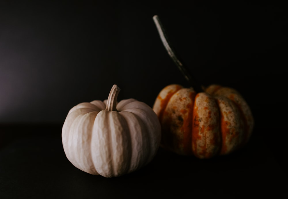 two green and yellow pumpkins