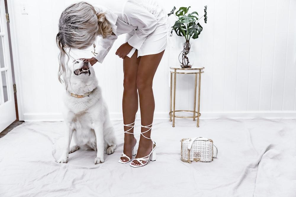 woman holding dog's head