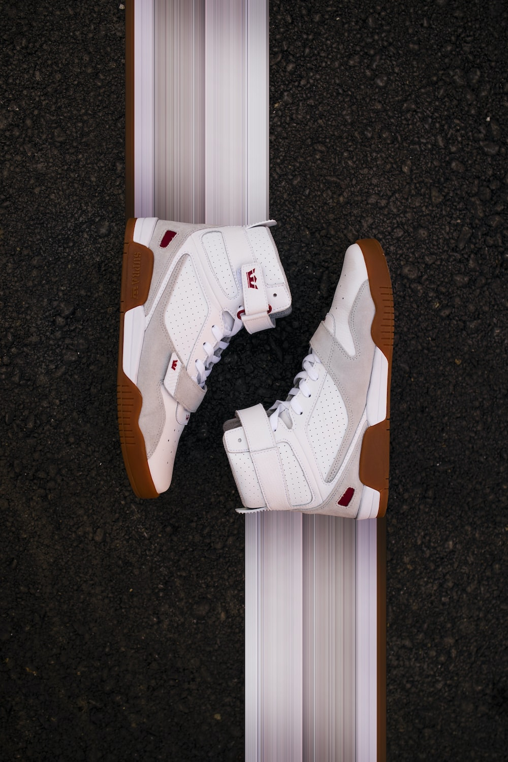 brown-and-white Nike Lebron James shoes
