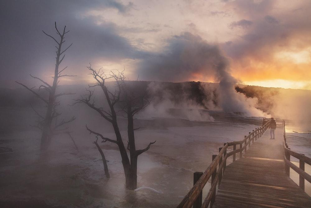 person near geyser