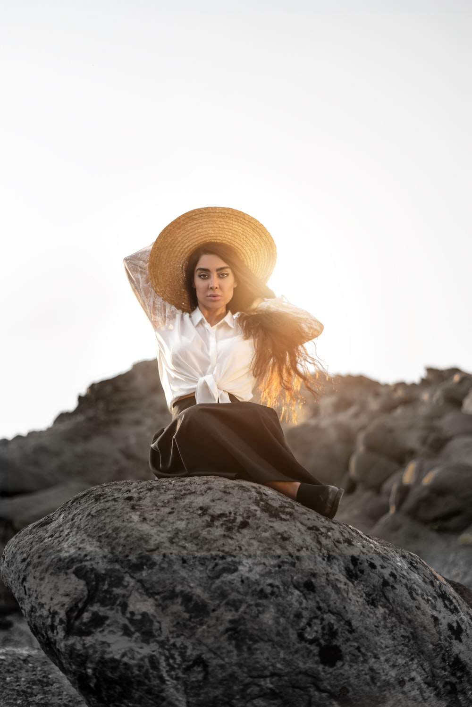 glaring woman sitting on rock