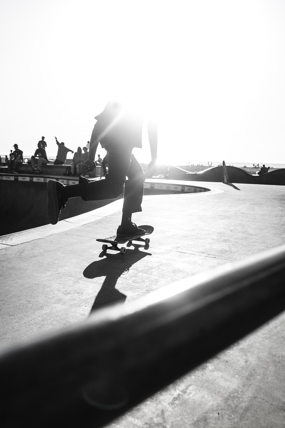 person riding skateboard on grayscale photography