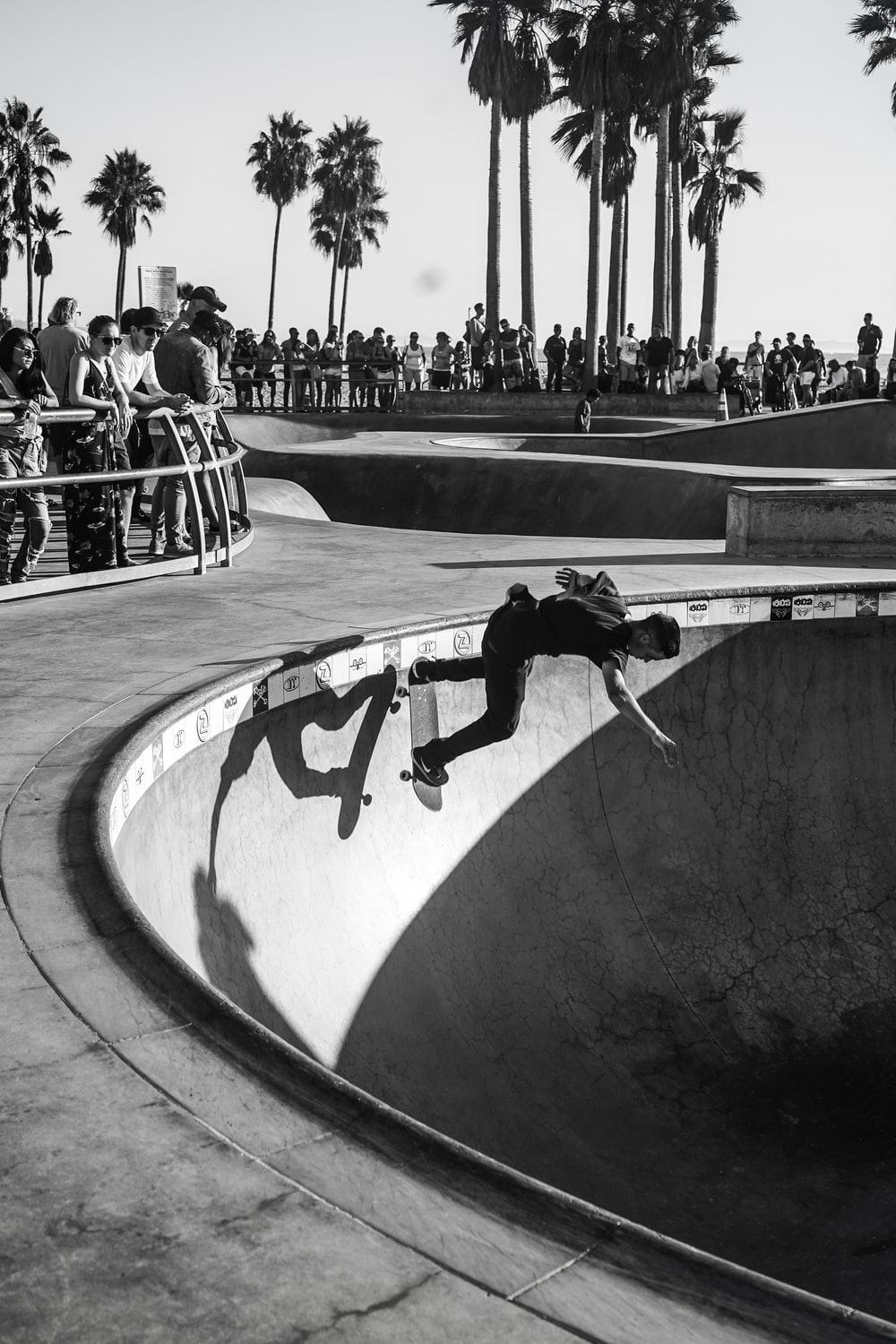 grayscale photography unknown person skateboarding outdoors