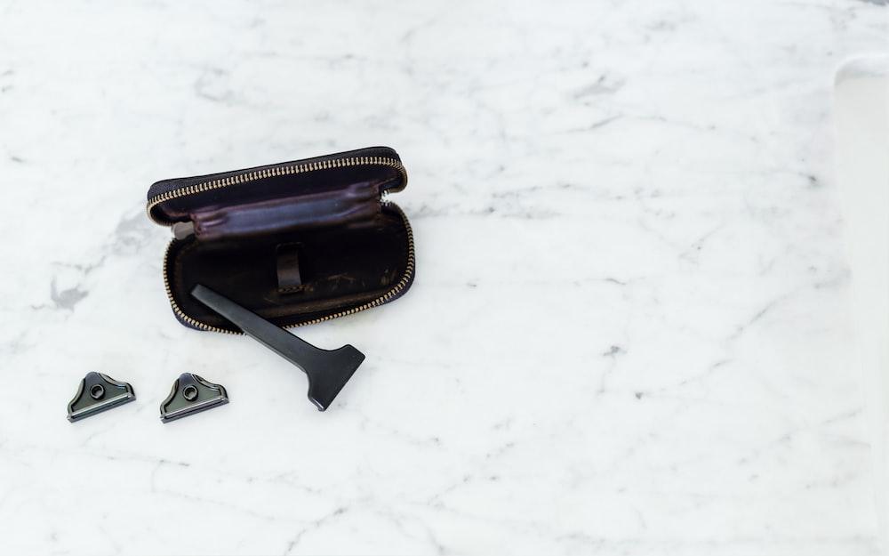 black tool with black zip case