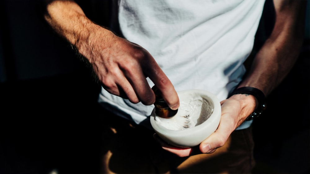 man holding white bowl