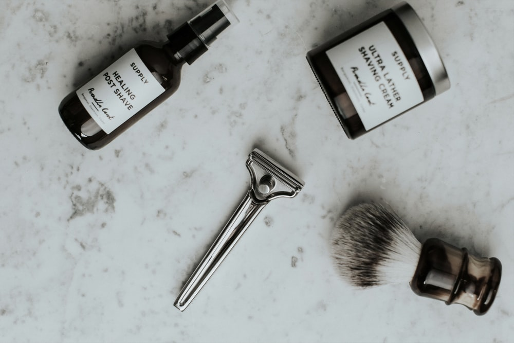 shaving cream bottle and silver portable shaver