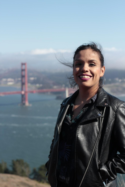 woman standing near Golden Gate bridge during daytime