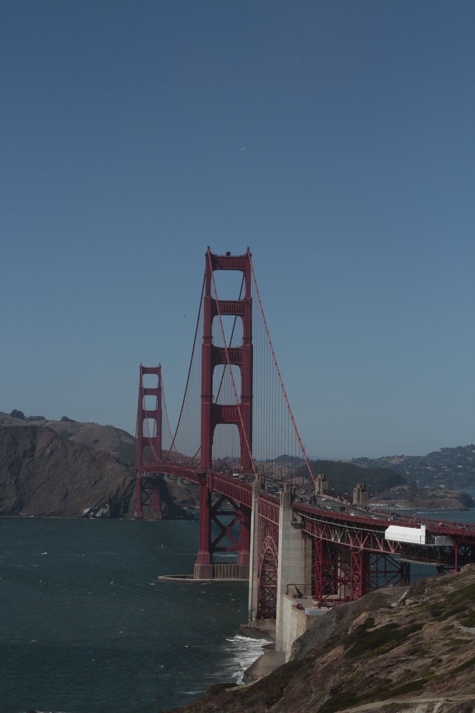 brown and gray concrete bridge under blue sky