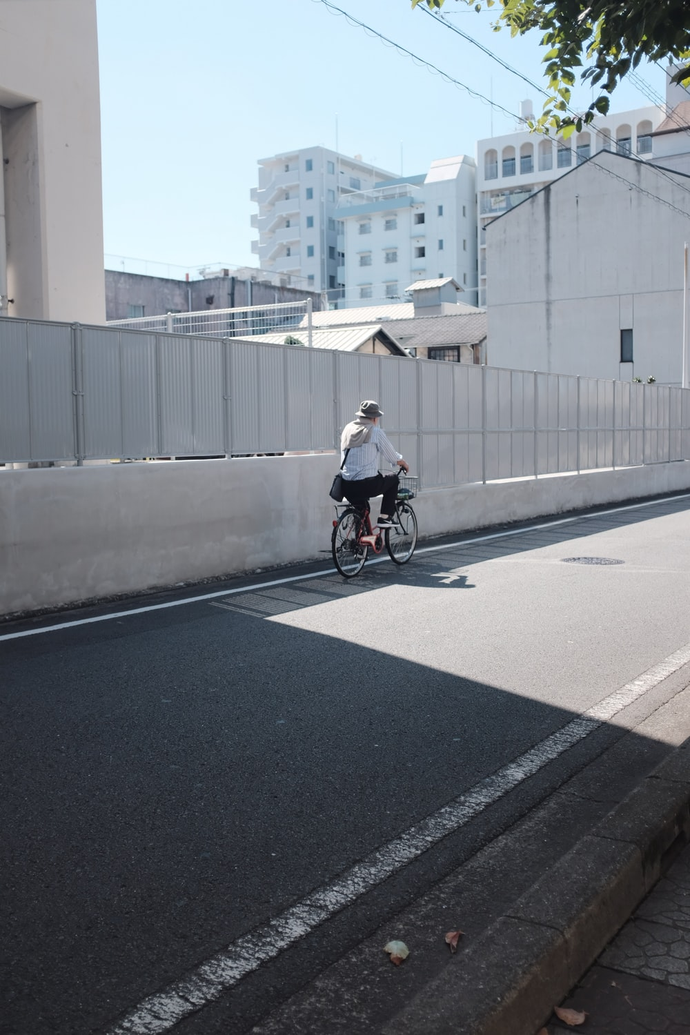 person cycling on road during daytime