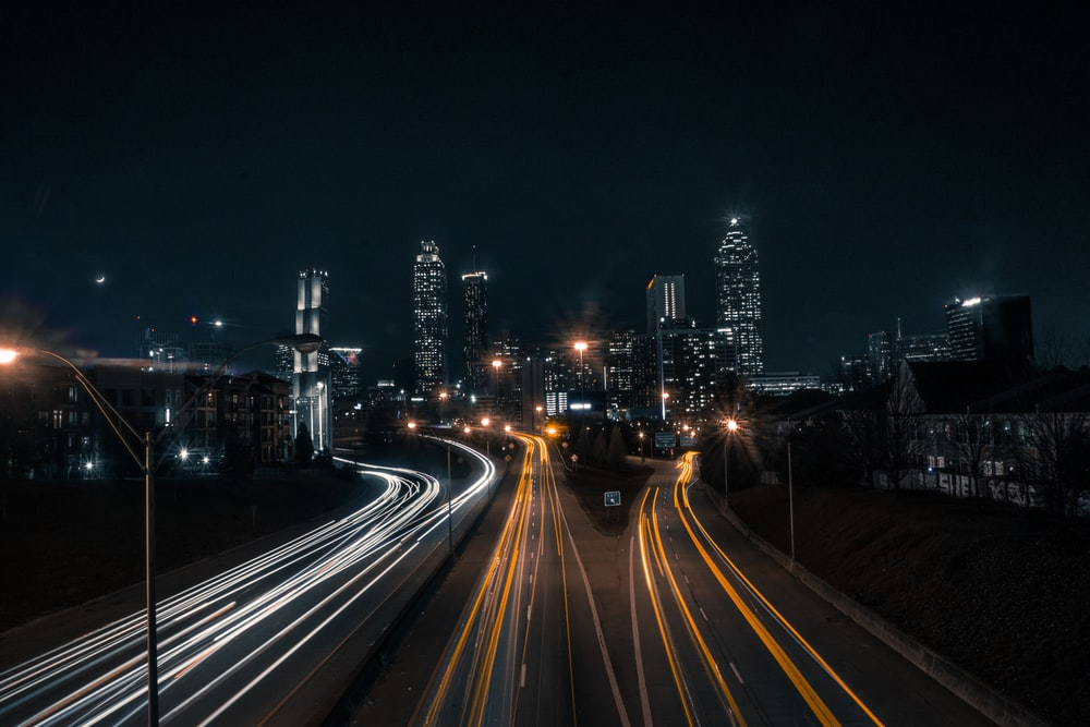timelapse photography of road and buildings during daytime