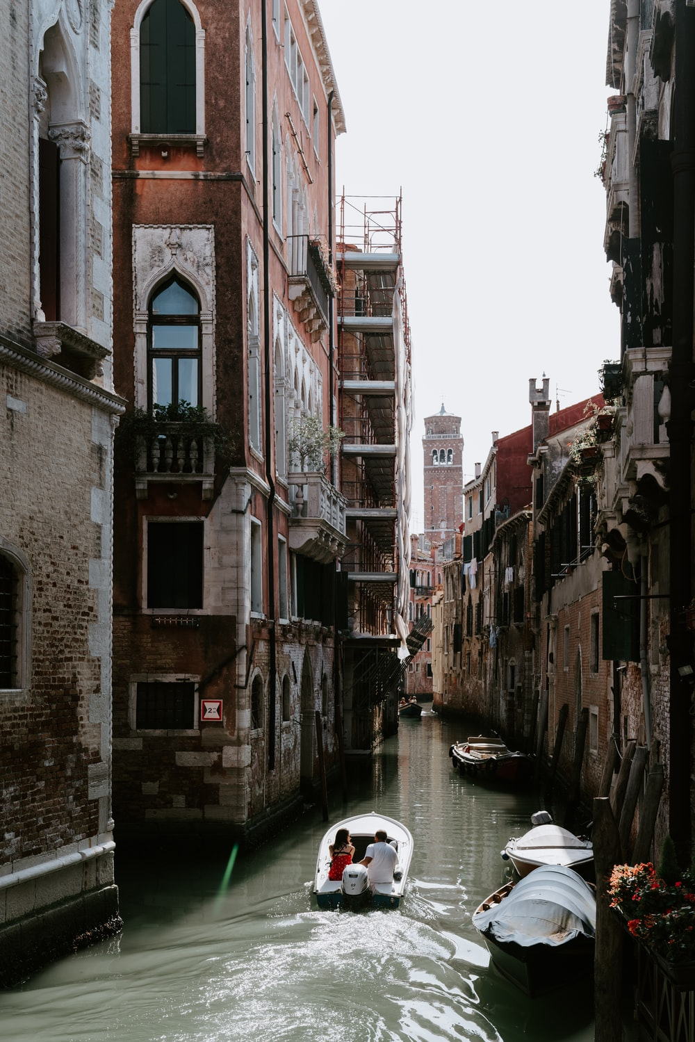 white boat on canal during daytime
