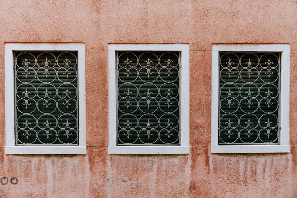 three white framed and window grills
