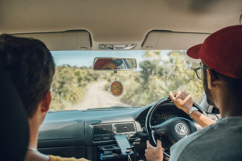 two men inside car