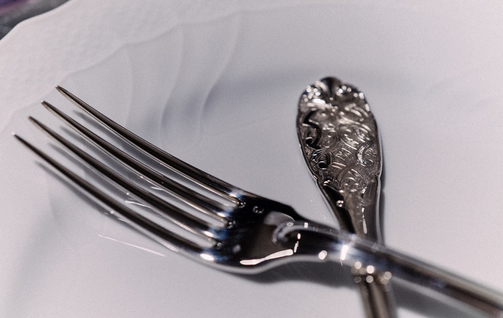 silver fork on white plate