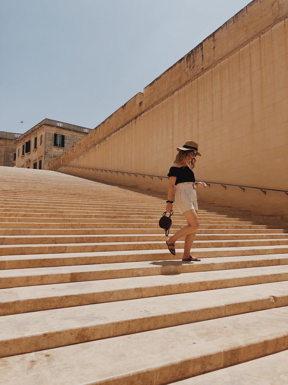 woman walking on stair during daytime