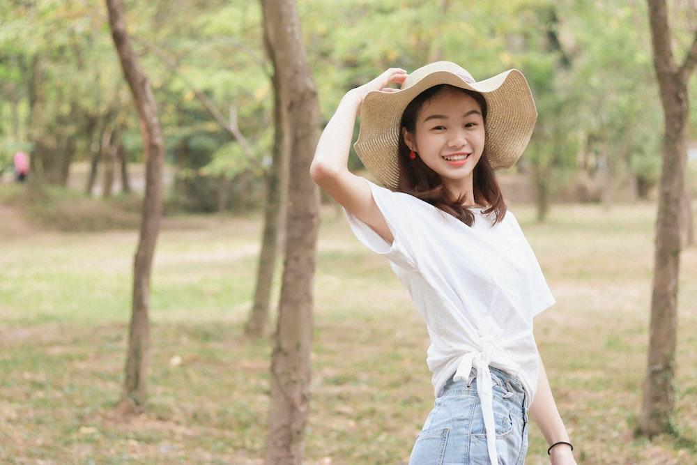 woman wears brown sun hat