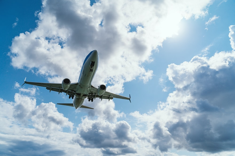 low-angle photography of airliner during flight