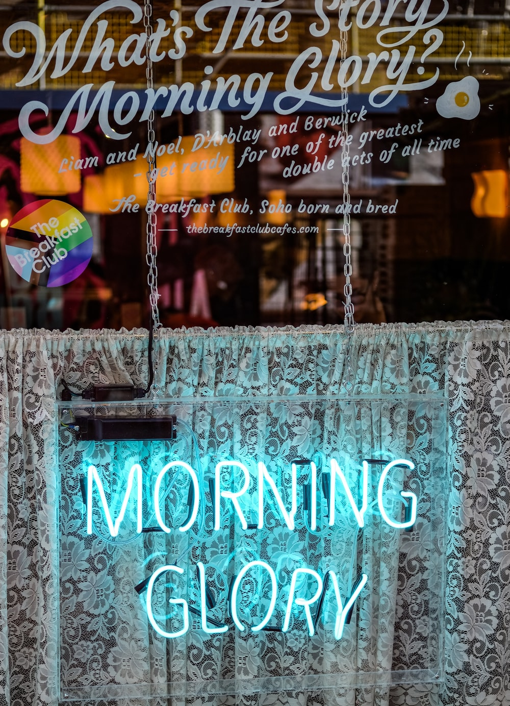 powered-on teal morning glory signage