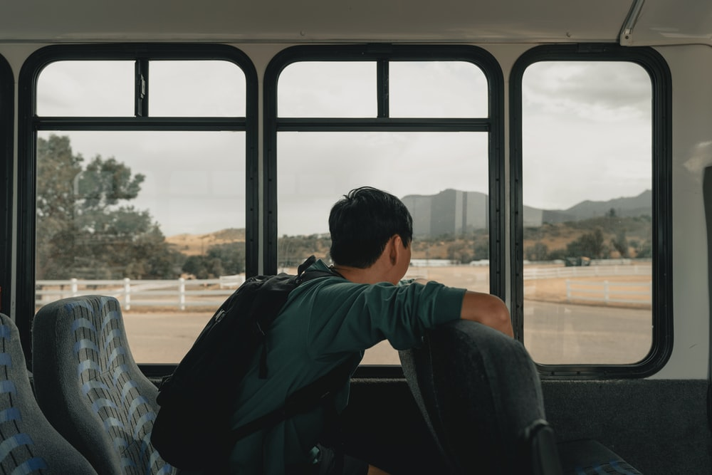 man sitting inside vehicle