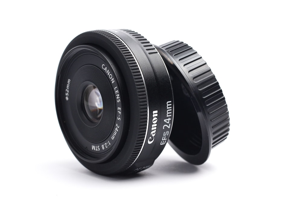 black Canon EFS 24 mm camera lens