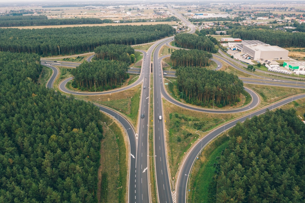 aerial view of asphalt roads and trees