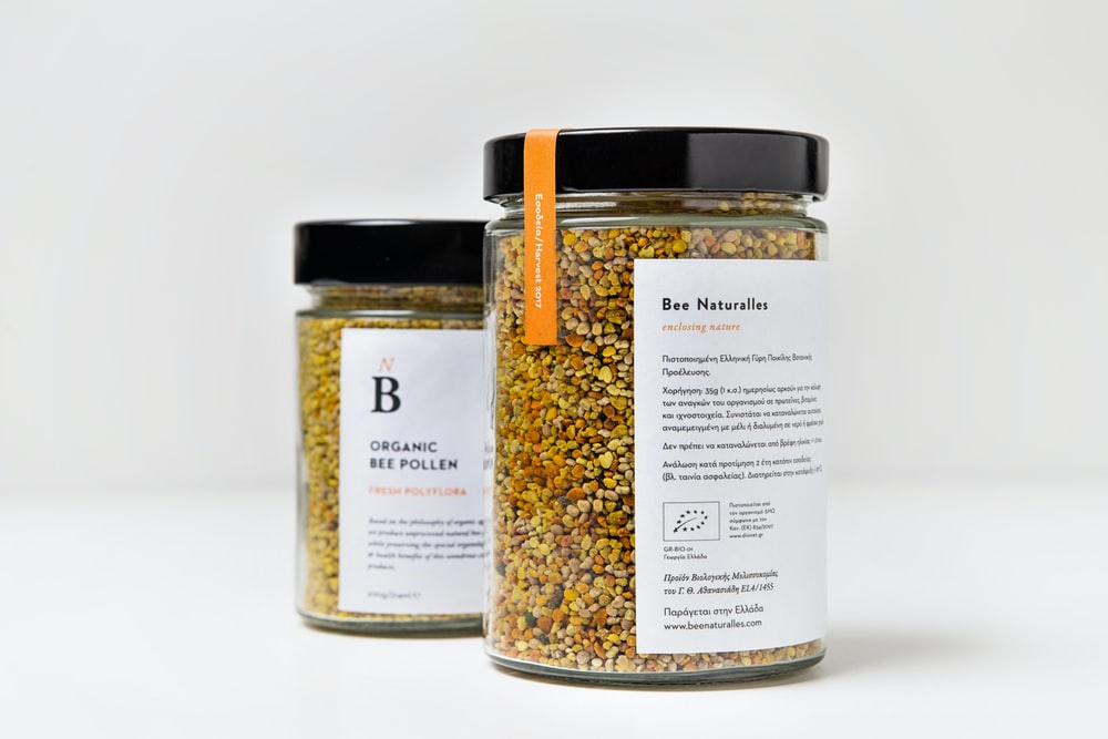 two filled jars with black cap