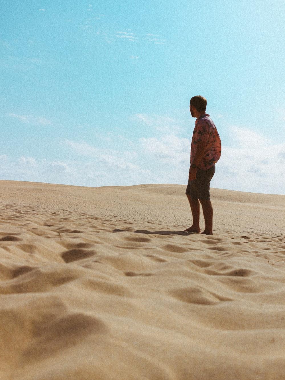 man standing on desert during daytime