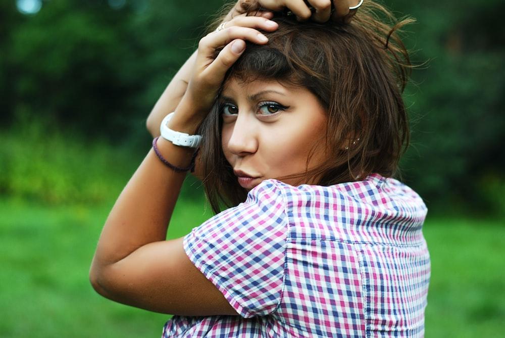 woman wearing multicolored plaid shirt