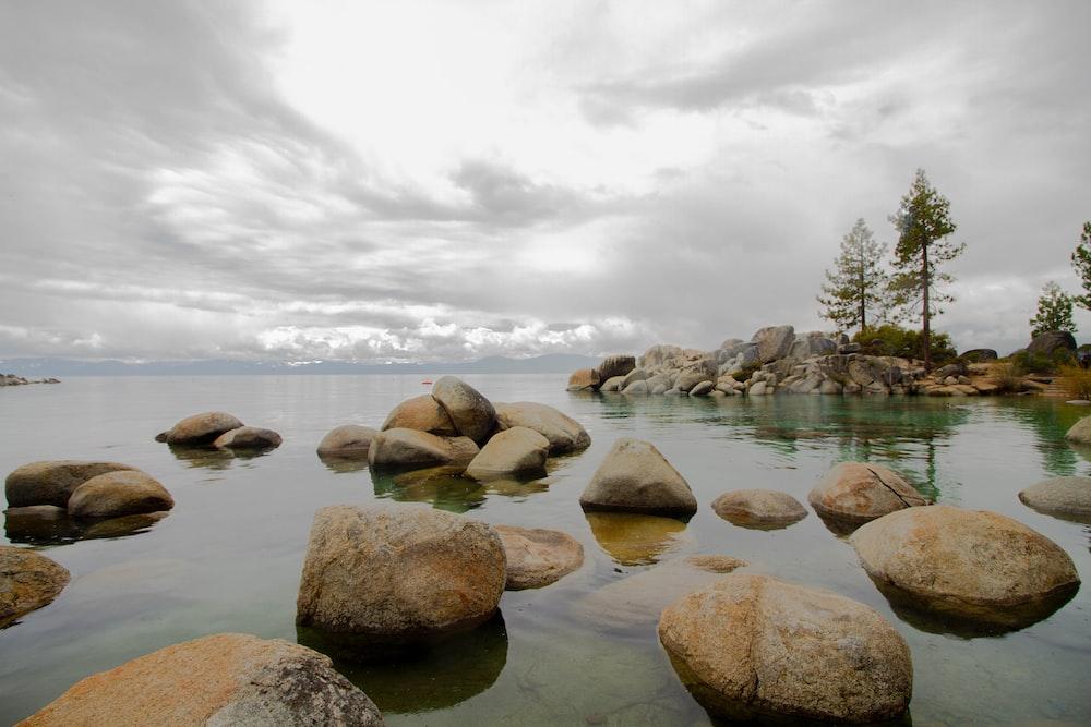 rocks on body of water