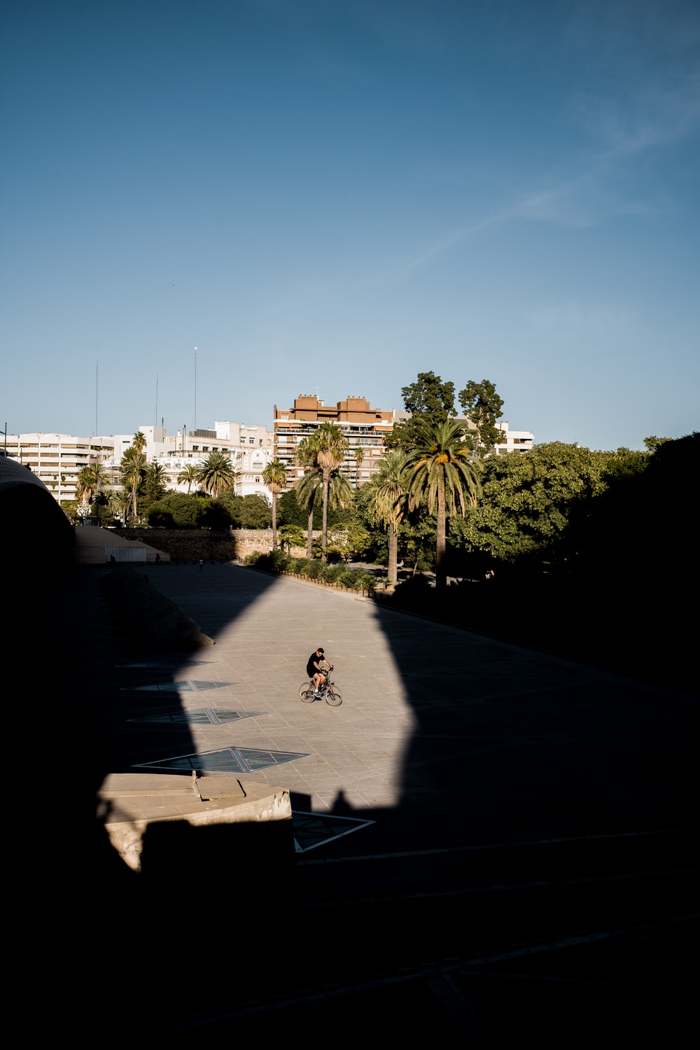 man riding on bicycle under clear blue sky